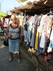 Client selling her wares at the market