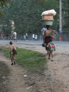 Woman walking her children to school