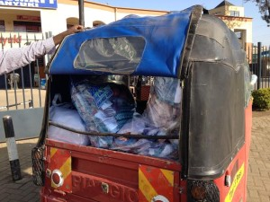 Kits loaded into tuk-tuk ready for transport to the school